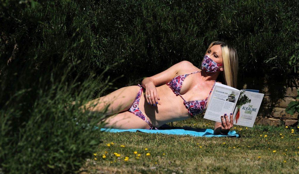 Mature Model Caprice Bourret Sunbathing in a Bikini