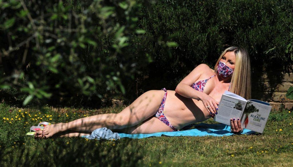 Mature Model Caprice Bourret Sunbathing in a Bikini gallery, pic 2