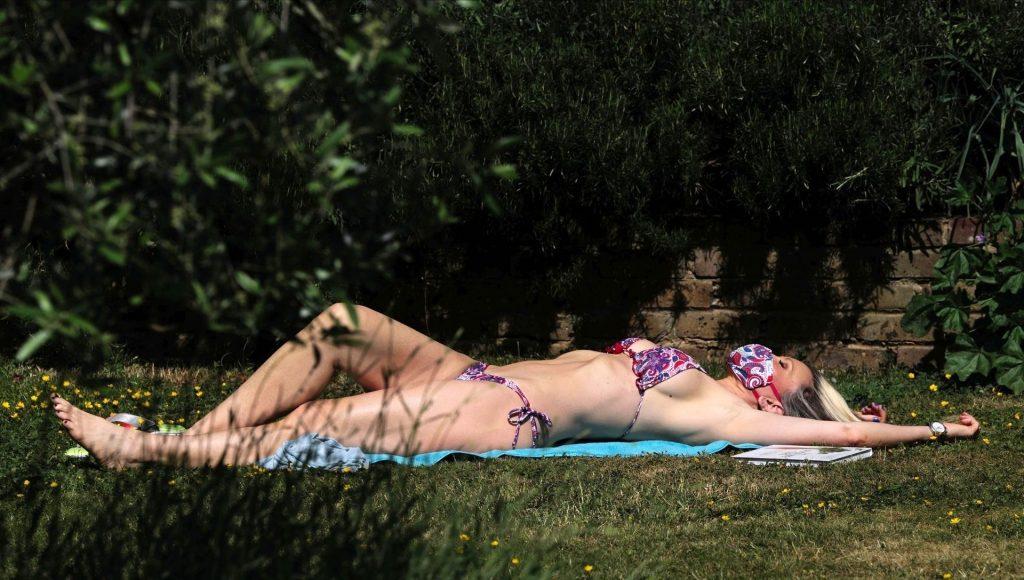 Mature Model Caprice Bourret Sunbathing in a Bikini gallery, pic 4