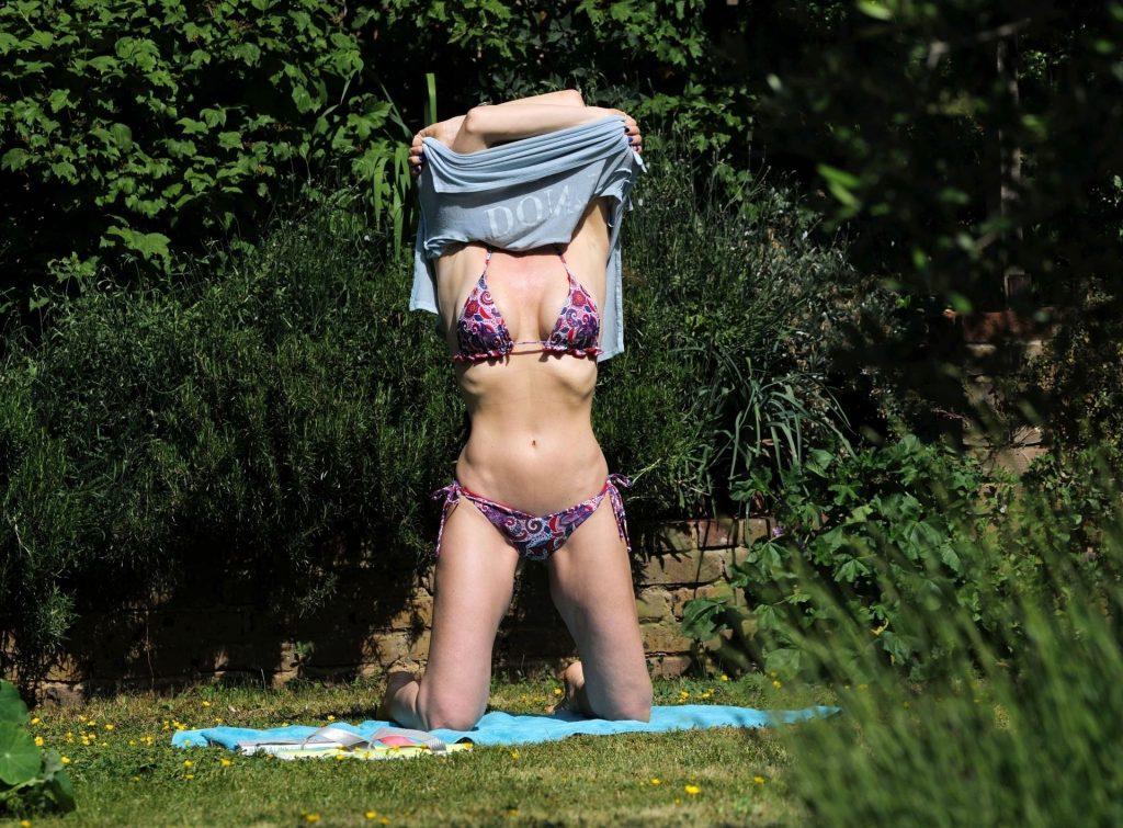 Mature Model Caprice Bourret Sunbathing in a Bikini gallery, pic 7