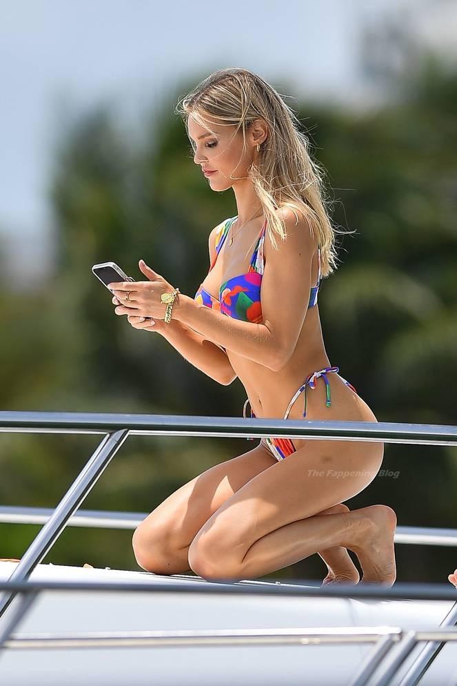 Joy Corrigan on Beach Swimsuit 14