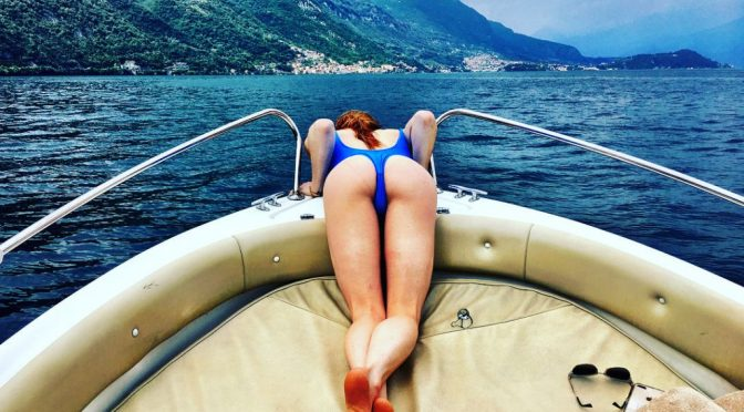 Swimsuit-Wearing Caity Lotz Happily Demonstrates Her Ass and Feet